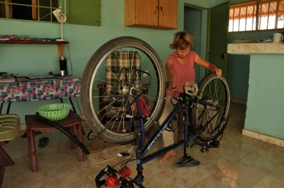 Checking, and repairing the bicycle, early morning before a wash