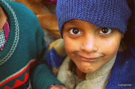 Boy from Taati, a tiny settlement where shepards can leave their sheep graze outide the school