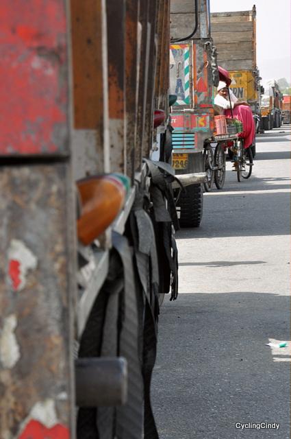 Kulfi Hiding Between Trucks