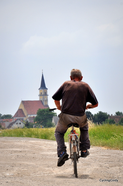 Man cycling to a village in Slovakia