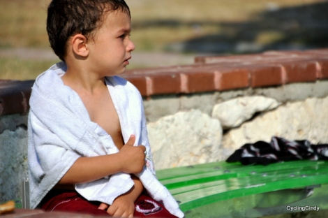 Little boy awaits his father at the Marmaris sea