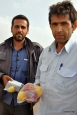 These 2 men passed me on the Iranian gulf coast and decided to buy me a few things