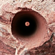 Drill hole of dynamite explosion