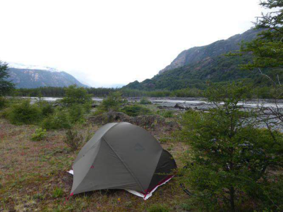 A very nice camp spot along a river in Patagonia. I liked to relax and read here...